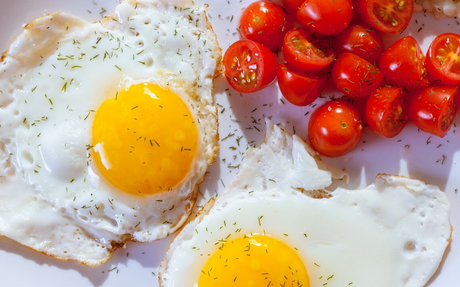 eggs and tomatoes on a plate